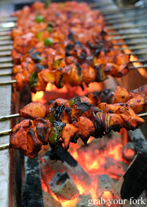 Chicken tikka skewers on charcoal at the Ramadan Night Market in Lakemba Sydney