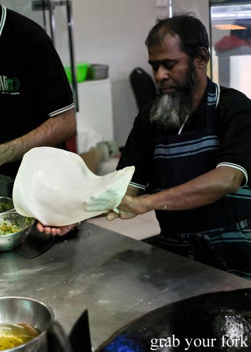 Flipping paratha at the Ramadan Night Market in Lakemba Sydney