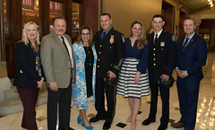From left - State Representatives Carol Hall, Tony D'Amelio and Nicole Klarides-Ditria, her husband, Seymour Police Officer Steven Ditria, State Representatives Stephanie Cummings, Waterbury Police Officer of the Year Jon Krchnavy and State Representative J.P. Sredzinski, posed for a photo after honoring the officers during National Police Week.