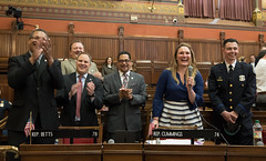 State Rep. Stephanie Cummings laughs with her colleagues (from left) Larry Butler, Tony D'Amelio, Ron Napoli Jr., and Gerry Reyes as she introduces Waterbury Police Officer of the Year Jon Krchnavy in the House of Representatives.