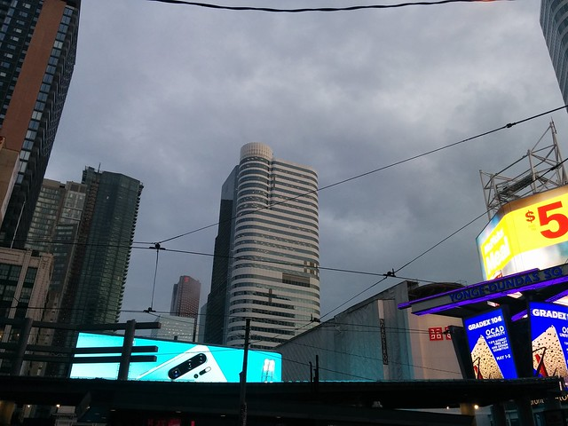 Looking south, Yonge-Dundas Square, amid grey clouds at evening #toronto #yongeanddundas #yongedundassquare #grey #clouds #evening #skyline