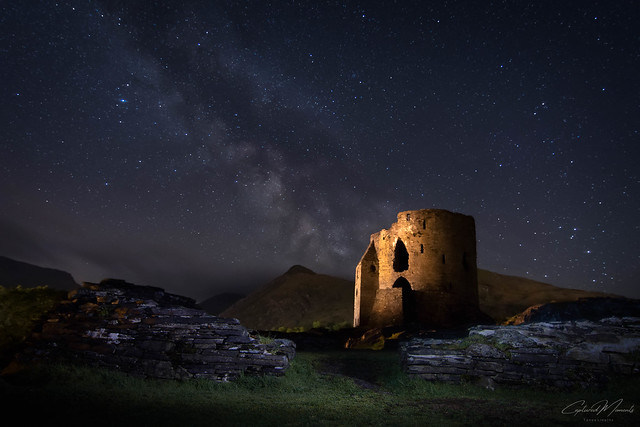 Dolbadarn Castle Llanberis and the Milky Way. Star lit skies shine above us .