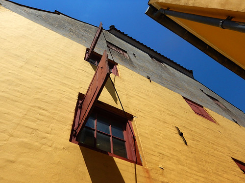 Yellow walls with red shutter in Koge, Denmark