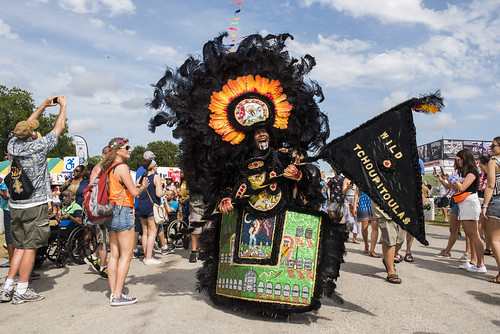 Flag Boy Giz with The Wild Tchoupitoulas Black Indians of Mardi Gras at Jazz Fest day 6 on May 3, 2019. Photo by Ryan Hodgson-Rigsbee RHRphoto.com