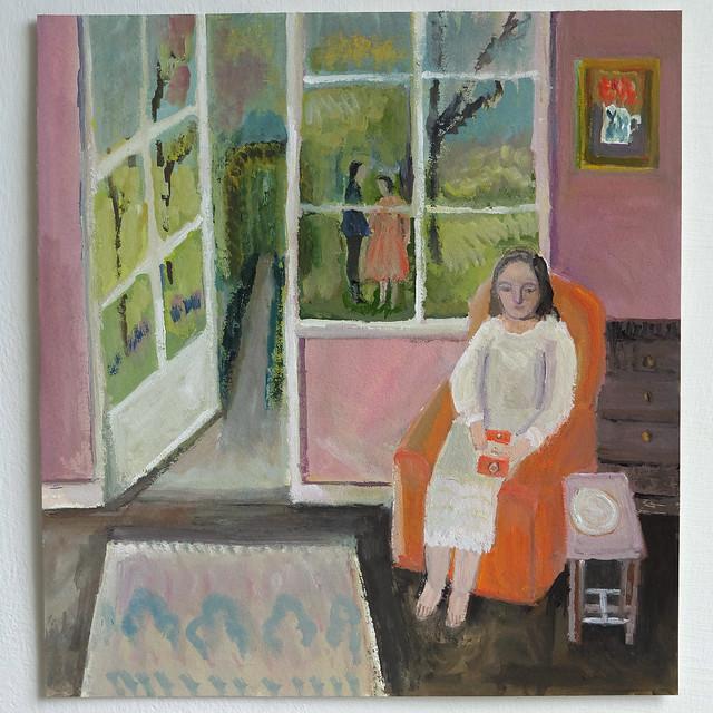 girl reading, doorway to a garden