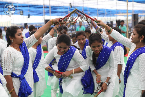 A traditional dance by ladies Sewa Dal volunteers