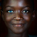 Beautiful african girl with heterochromia iridis causing two different colored eyes, Moyen-Comoé, Abengourou, Ivory Coast by Eric Lafforgue