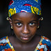 Portrait of a Peul tribe girl with colorful clothes, Savanes district, Boundiali, Ivory Coast by Eric Lafforgue