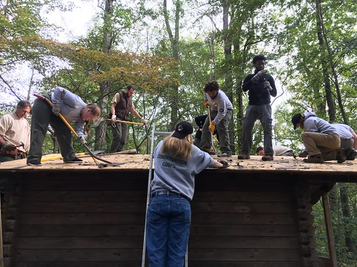 Photo of Maryland Conservation Corps crew repairing a cabin roof at a state park.