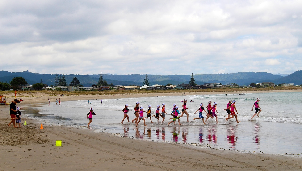 Children running into the water in New Zealand