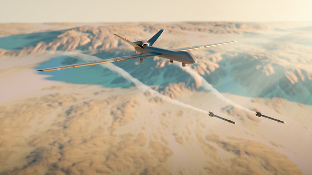 Military drone rocket attack above desert