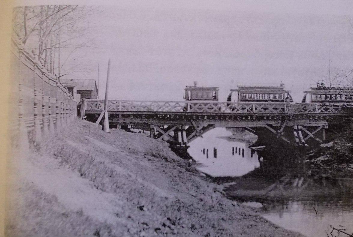 Паровая конка на мосту у Александровского завода. 1870-е