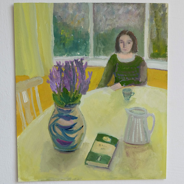 woman at a table with purple flowers