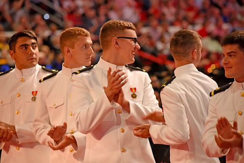 ROTC graduates applaud their leaders and recognized veterans.