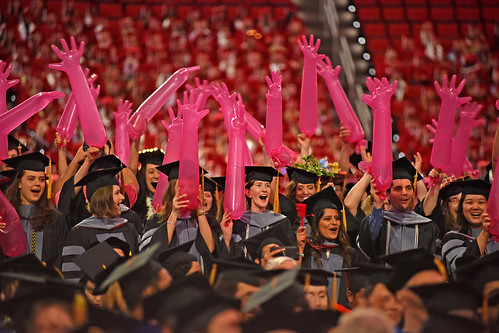 College of Veterinary Medicine graduates give each other a hand.