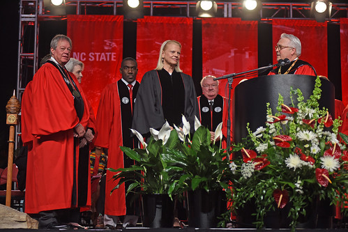 Chancellor Randy Woodson (right) reads the proclaimation honoring IBM CEO Ginni Rometty with a doctorate degree.