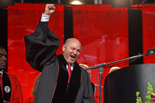 Honorary doctorate recipient Craig Dykers gets pumped as he accepts the honor.