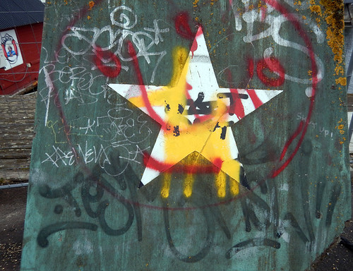 Star plus graffiti in the counter-culture area of Copenhagen called Christiania, Denmark