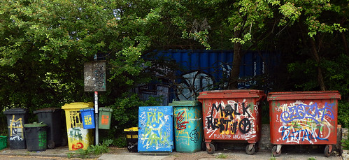 Bright graffitied dumpsters in the counter-culture area of Copenhagen called Christiania, Denmark