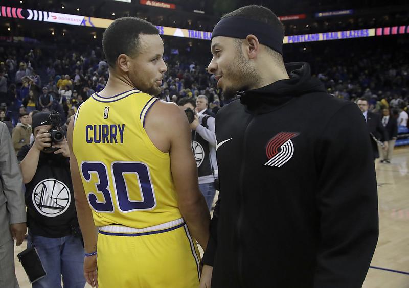 Stephen Curry(左)與Seth Curry(右)。(達志影像資料照)