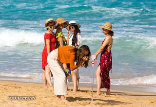 Selfie. Chinese girls on Nai Harn beach, Phuket, Thailand