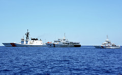 The U.S. Coast Guard Cutter Bertholf (WMSL 750), left, moves in formation with the Philippine Coast Guard vessels Batangas, center, and Kalanggaman during an exercise, May 14. (U.S. Coast Guard/CPO John Masson)