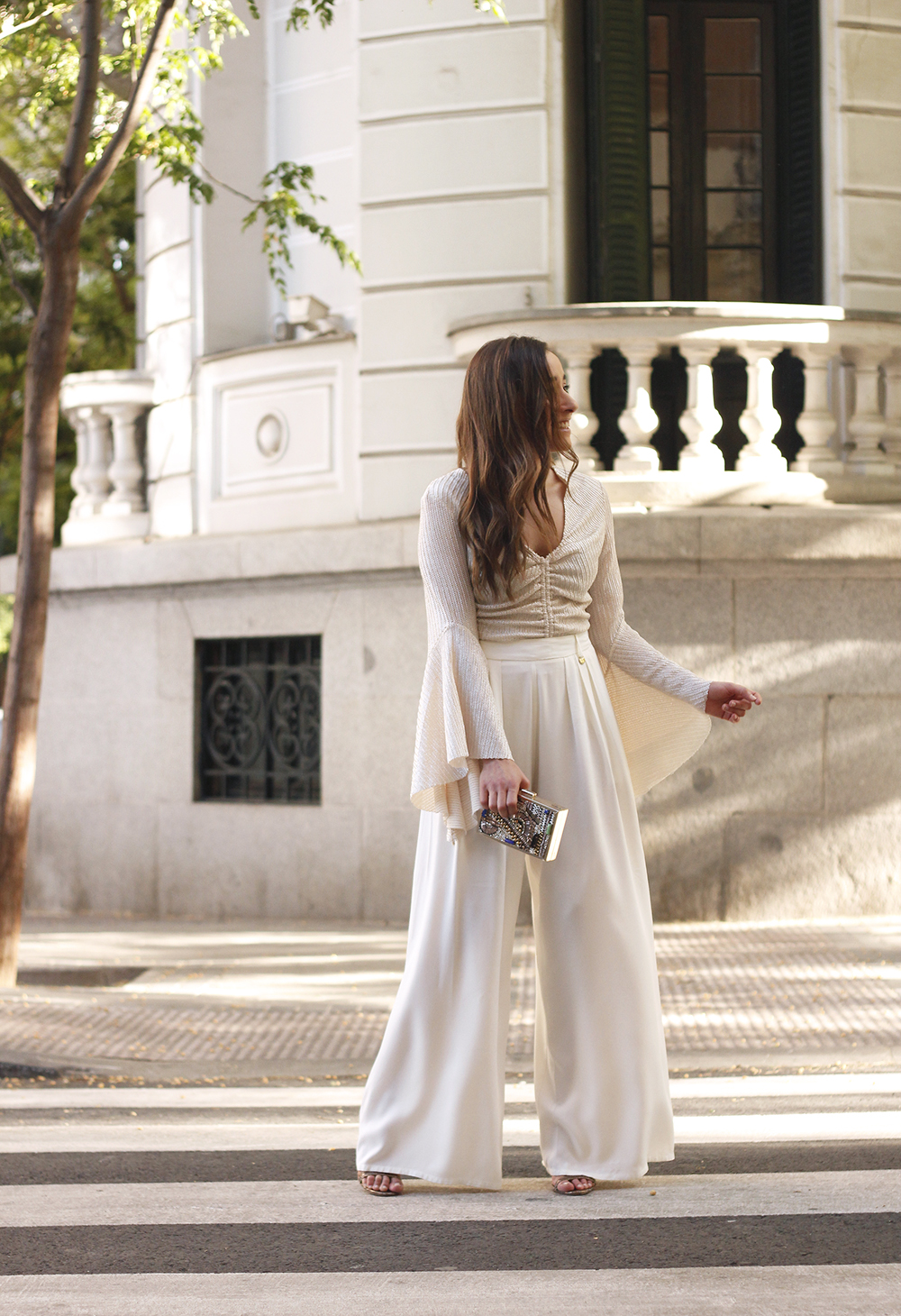 look de invitada lola casademunt white palazzo pants golden top street style outfit 20196