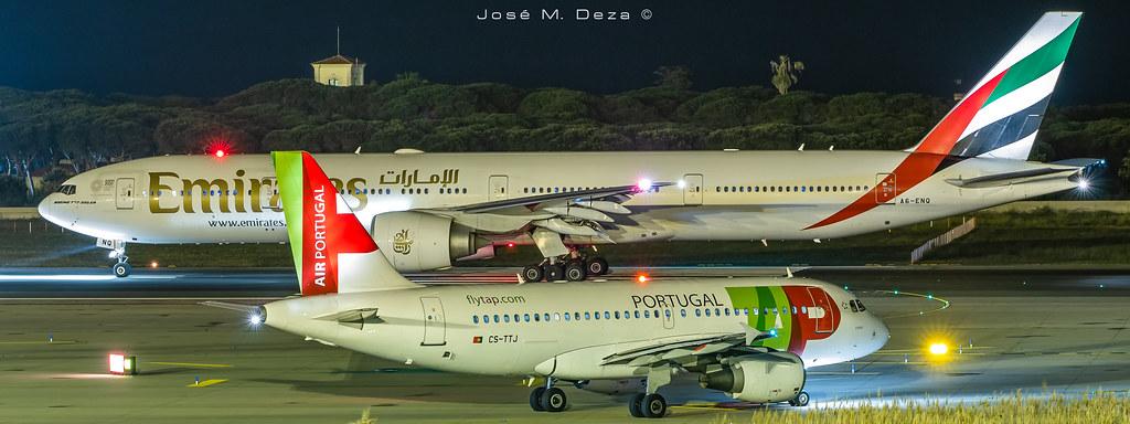 Emirates B777-31HER A6-ENQ & TAP A319-111 CS-TTJ