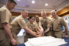 The 2018 Sailors of the Year cut a celebratory cake after the 2018 SOY pinning ceremony. (U.S. Navy/CTN2 Winter Griffith)
