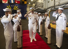 Rear Adm. Fred Kacher salutes sideboys aboard USS Wasp (LHD 1) during the change of command ceremony. (U.S. Navy/MC1 Jeremy Starr)