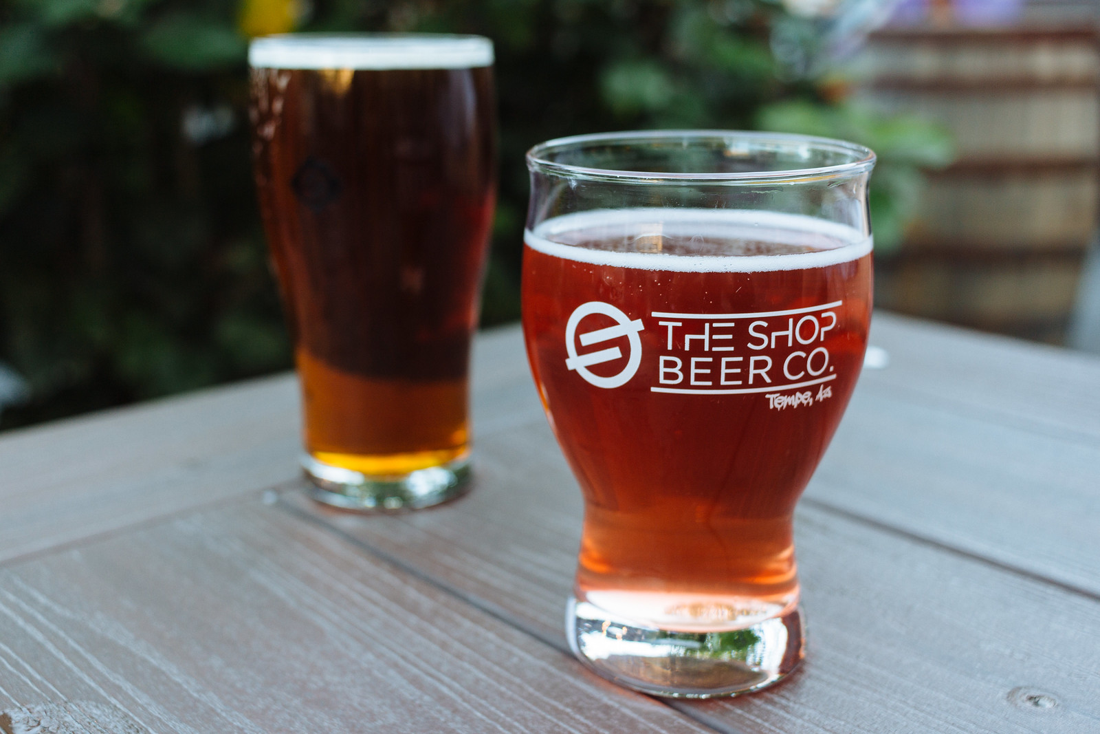 Two glasses of beer on a wooden table