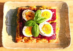 FLATBREAD WITH PICKLED RED BEETS, GUACAMOLE AND EGG