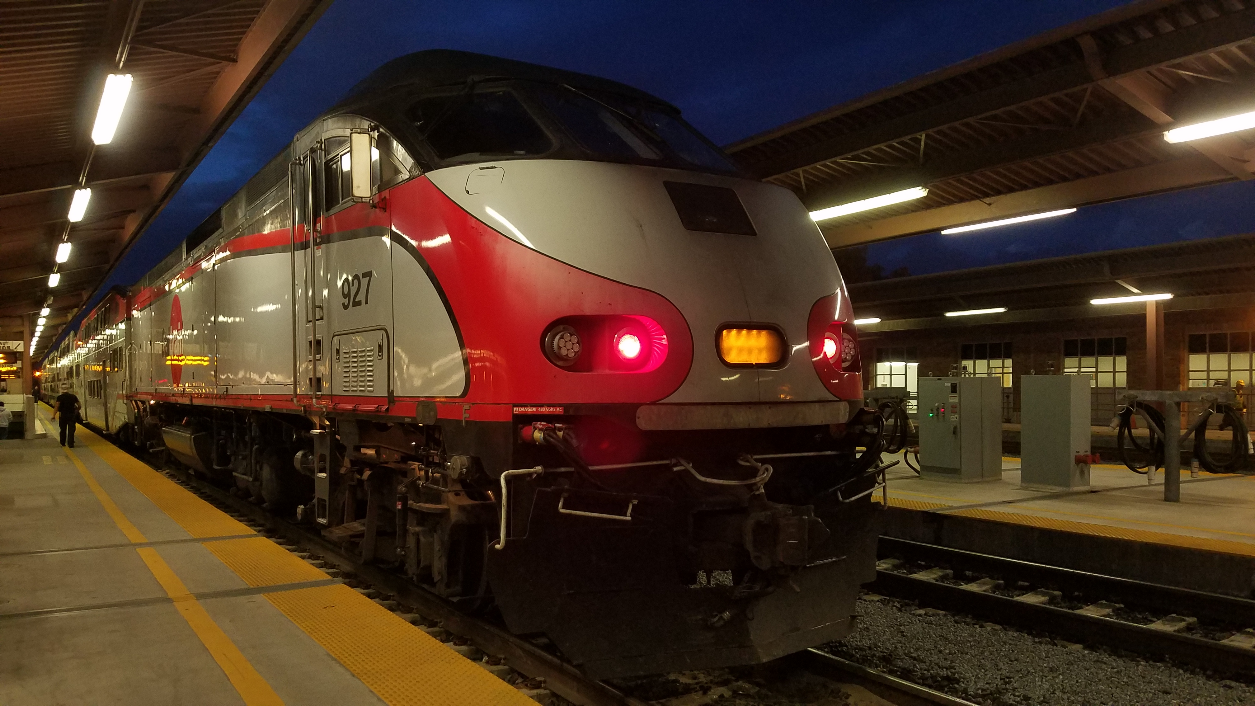 Caltrain locomotive unit 927 acting as a trailer on a northbound train at Belmont Station