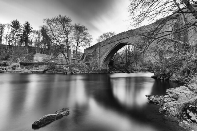 fine art, long exposure, black and white shot of the ancient and charming Brig o'Balgownie over the River Don, Old Aberdeen, Aberdeen, Scotland