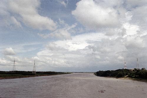af2880mmf3345g bridge travelphotography cloudy brahmaputra fujicolorc200 film nikonf80 bangladesh nikonn80 travel pacificimageprimefilm3650pro3 transmissionlines bluesky fujifilm river analog sherpur