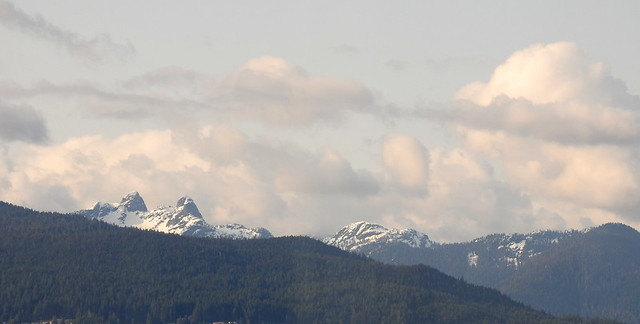 THE LIONS OF THE COASTAL MOUNTAIN RANGE,   AS SEEN FROM VIEW FROM THE WATERFRONT HOTEL, VANCOUVER,  BC.