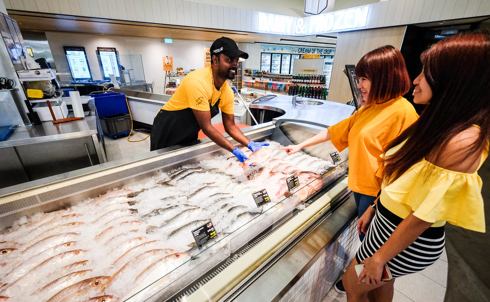Selecting a Fresh Fish at Habitat by Honestbee