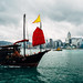 Hong Kong City skyline with tourist sailboat