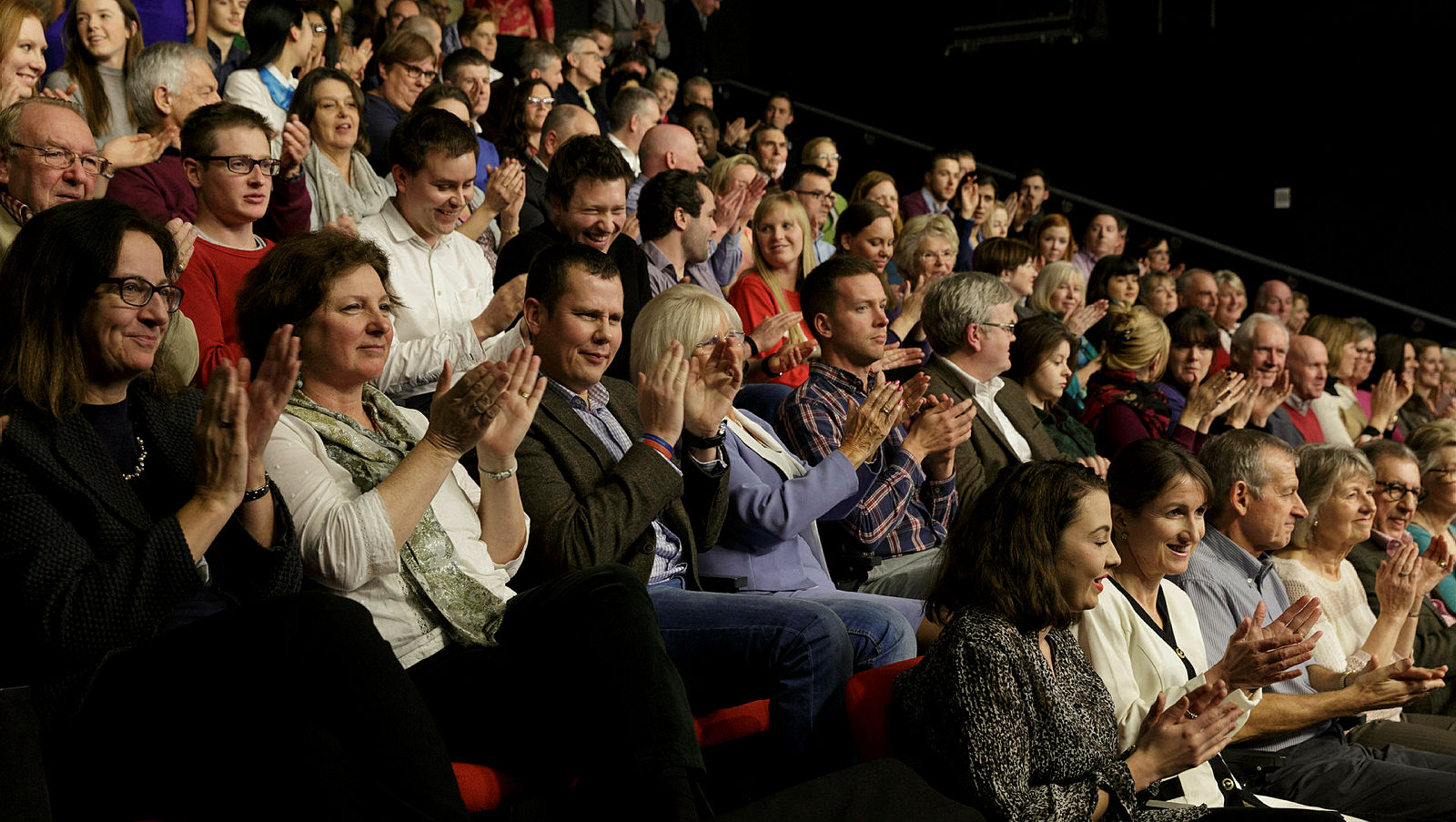 An audience applauding in The Edge theatre