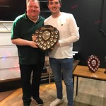 Euan Storrier is presented with his award by local darts star John Henderson