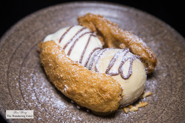 "Goreng Pisang ""Split"" - fried banana, salted gula java (palm sugar) ice cream, vanilla ice cream, chocolate sauce, caramelized crispy rice"