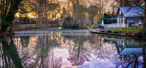 cheltenham fujifilmx100t gloucestershire pittvillepark boathouse lake mirror refelctions refllective soft softly sunset trees water