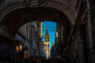 View of sun hitting the exterior of the Cathédrale Notre-Dame de Rouen from Gros-Horloge Arch on Rue du Gros Horloge, Rouen, France-86a