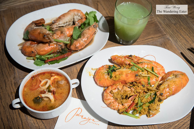 River prawns with garlic sauce, Shrimp with curry ginger sauce, fresh guava juice, and a bowl of tom yum goong