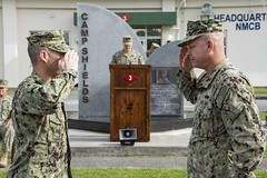 OKINAWA, Japan (April 19, 2019) Cmdr. Angel Santiago, left, commanding officer of Naval Mobile Construction Battalion (NMCB) 4, receives authority of Camp Shields in Okinawa, Japan from Cmdr. Joseph Harder, commanding officer of NMCB-3, during a Relief in Place/Transfer of Authority ceremony. Seabees are the expeditionary engineering and construction experts of the Naval service. They provide task-tailored, adaptable and combat-ready engineering and construction forces that deploy to support Navy objectives globally. (U.S. Navy photo by Mass Communication Specialist 2nd Class Matthew Dickinson/Released)