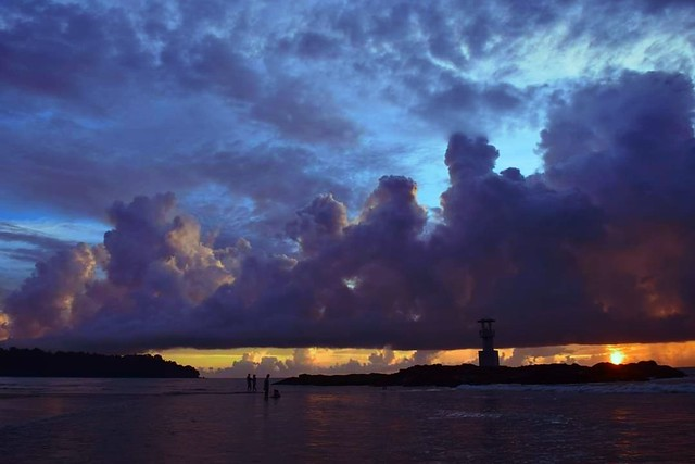 Stormy sunset on Nangthong beach, Khaolak, Thailand.