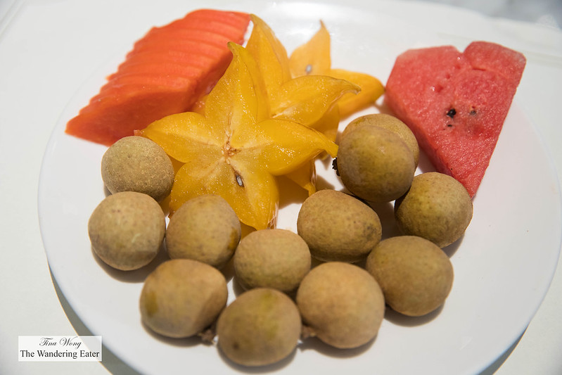 Plate of fresh Thai fruits - papaya, star fruit, watermelon, and longan