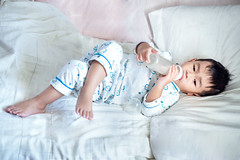 Asian boy drink a milk from bottle
