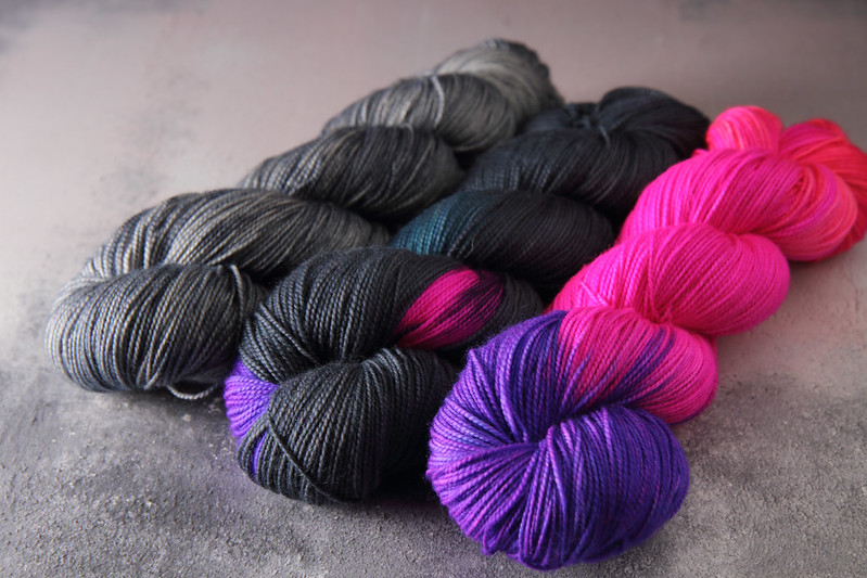 Hand dyed yarn skeins in grey and neon pink