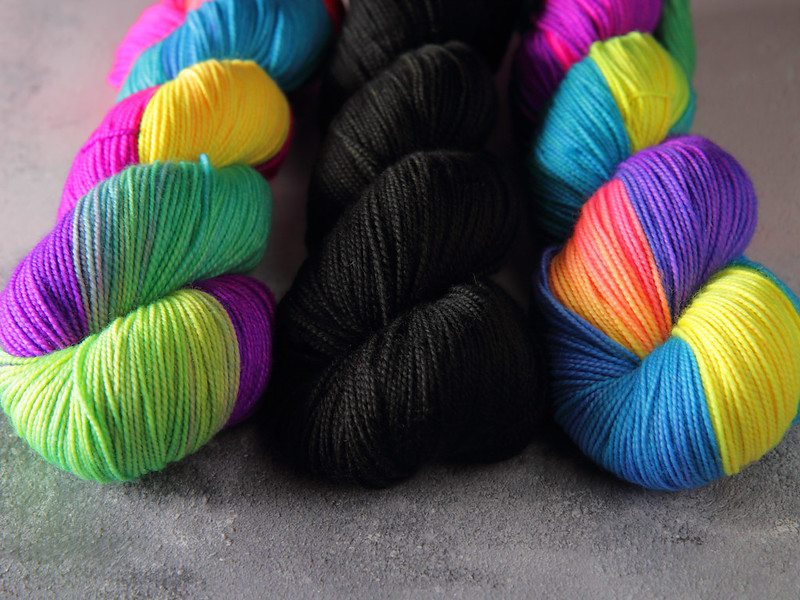 It's a Stitch Up Favourite Sock yarn in 'Glowsticks' and 'Black, Like My Soul'